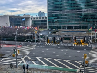 A photo of the NY street of the United Nations building