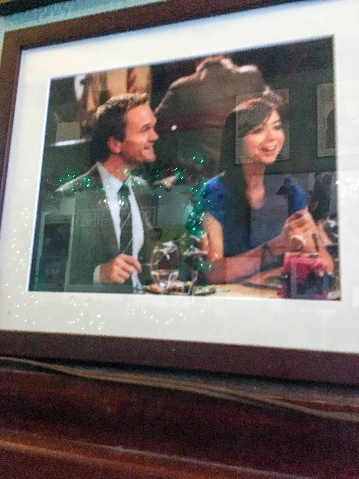 Barney and Lily from How I Met Your Mother drinking at the bar.